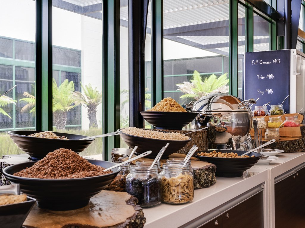 Selection of cereals and mueslis in bowls as part of the buffet breakfast selection on offer.